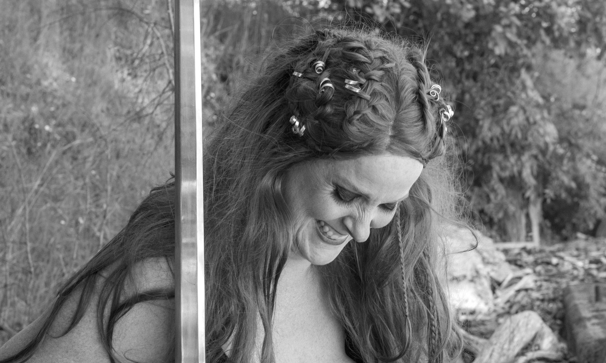 playwright notes, shield maiden, Viking warrior, Viking woman warrior, Shield Maiden play, play, theatre, strong women, historical women, viking warrior, viking warrior woman, black and white photography, stage still, Melanie Teichroeb