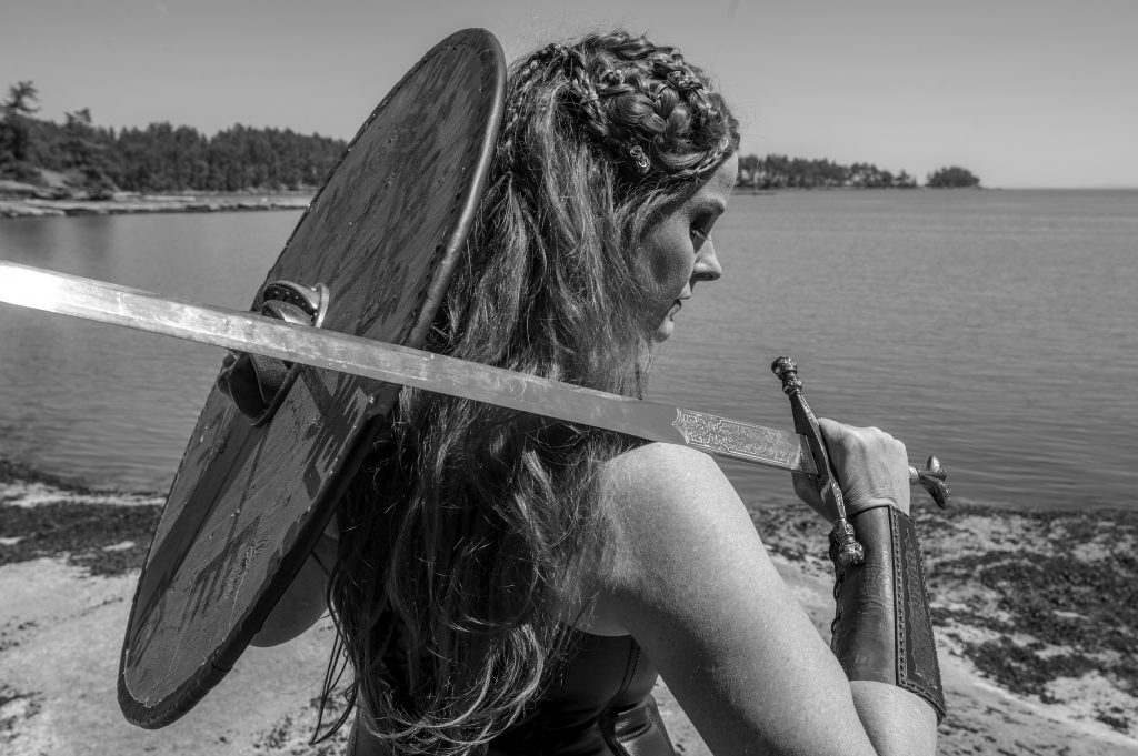 contact, shield maiden, Viking warrior, Viking woman warrior, Shield Maiden play, play, theatre, strong women, historical women, viking warrior, viking warrior woman, black and white photography, stage still, Melanie Teichroeb